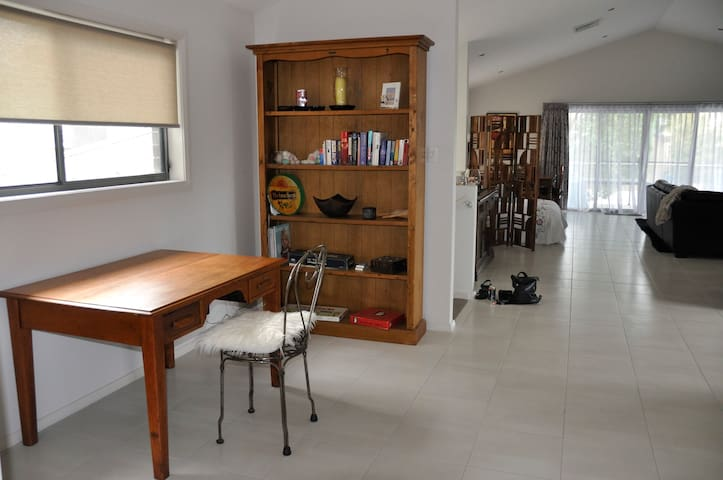 Study area, free wifi and library with games upstairs for guests use