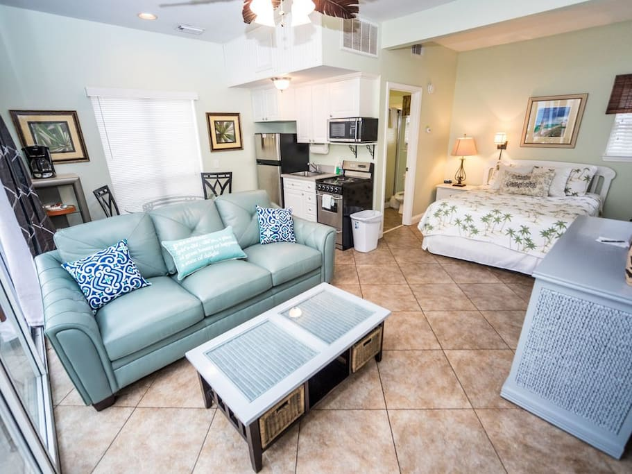 Studio unit with queen bed, new sofa couch, and kitchenette.