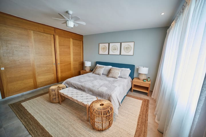 Master bedroom with king sized bed, smart TV and imported furnishings from Room & Board and Serena & Lily