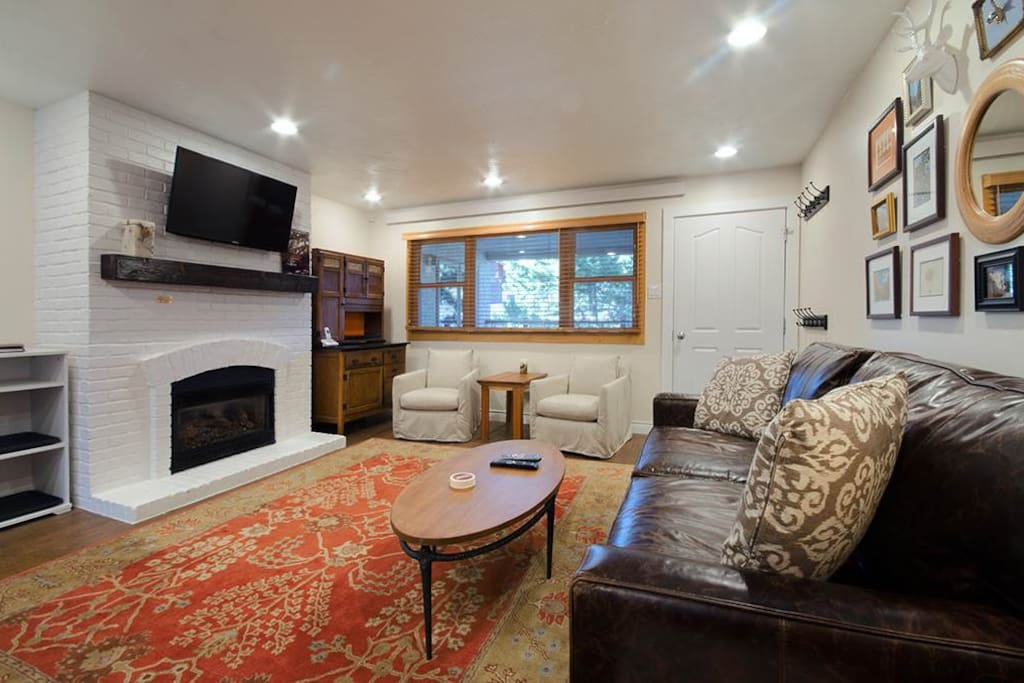 Living room offers plenty of seating, gas fireplace, and large screen TV