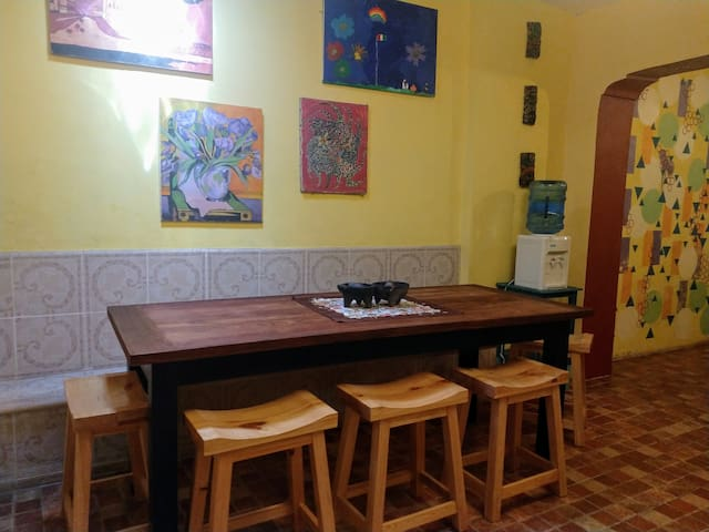 Breakfast is usually served at the kitchen table, but this beautiful dining table made of local Tzalam wood can seat larger groups and is the perfect place for a card or board game during a tropical storm (ask to see our collection of games!)
