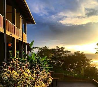 Double room IXORA with partial ocean view balcony