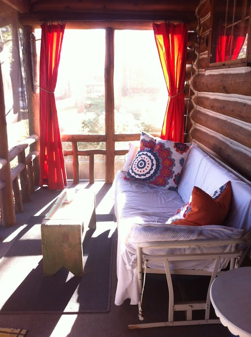 Porch on a sunny day.  Photo compliments of guest, Julia.