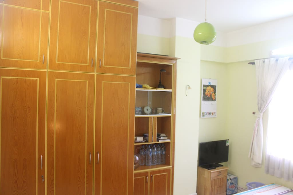 The room features spacious cabinets for all your belongings.