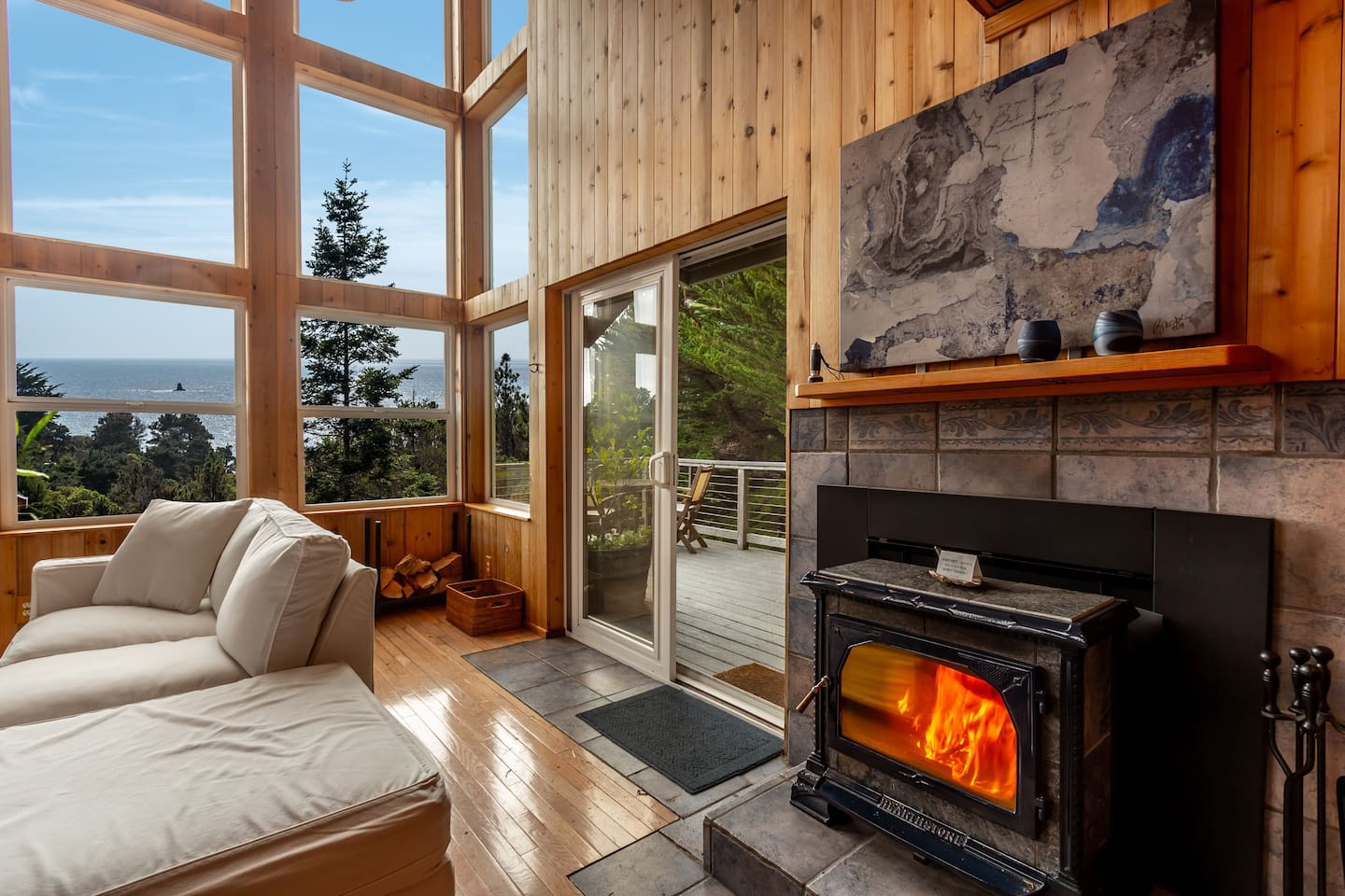 Relax in the Living Area with great views of the ocean and forest.