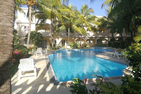 Le Palmier Holidays |Beach |Pool |Tropical Garden