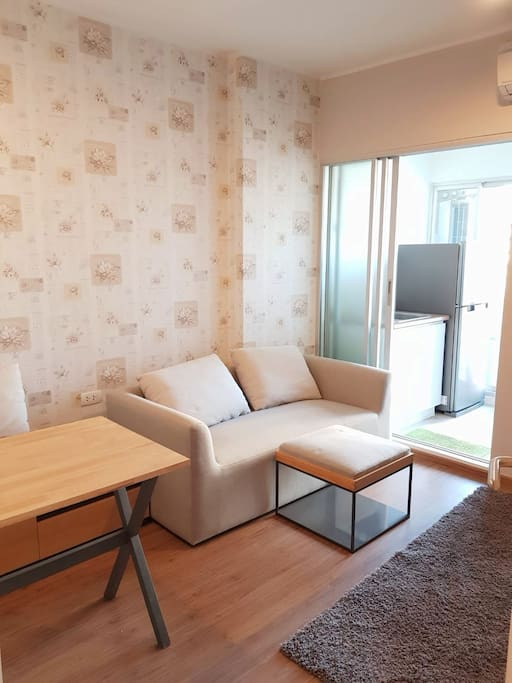 Cozy living room with fitted dining table and sofa. After a long day of working or travelling, you can rest here.