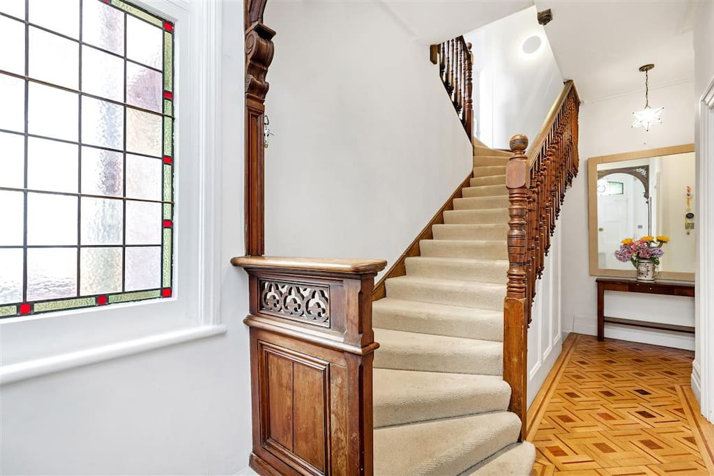 Entrance Hall with original victorian mahogany staircase, parquet and stained glass window
