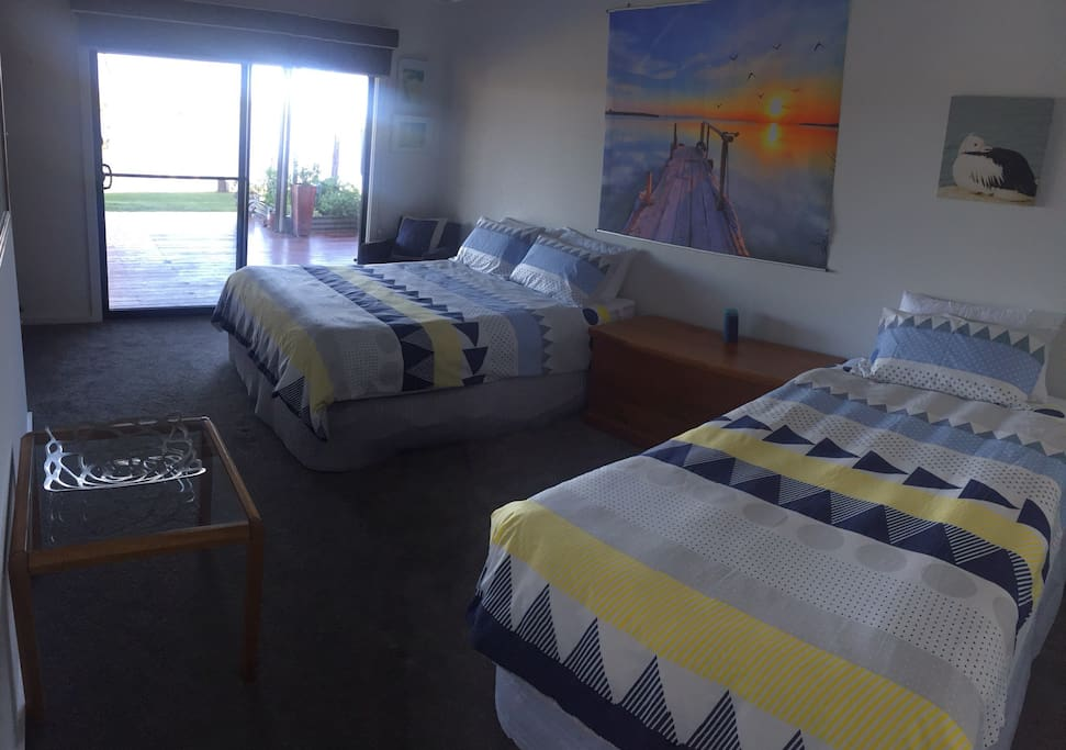 Room with a view! Spacious bedroom 1 has a comfortable Queen Size bed plus a King Single bed....