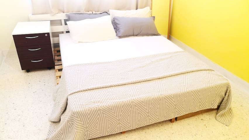 Ching's room - fully air conditioned, double bed with silky plain clean sheets coupled with four fluffy pillows and a beautiful blanket.   5 stars cleanliness, comfort, hygiene and value for money!