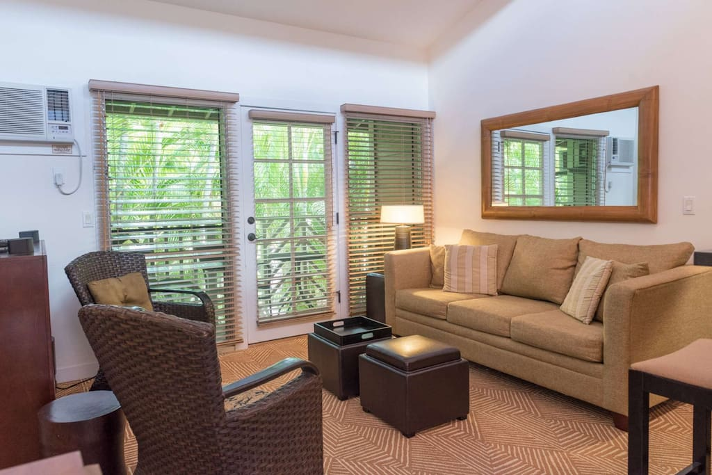 Bright and airy living space - lots of natural light - opens to small lanai.