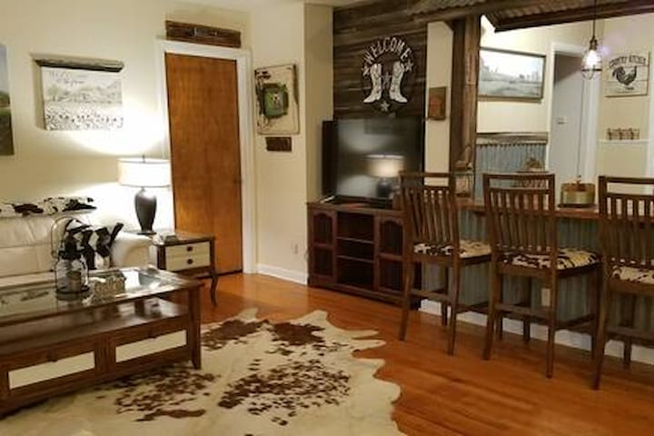 Wild west living area with built in table and bar stools to create the old west feel! Table will seat six, but there are plenty of additional chairs and TV trays as well!