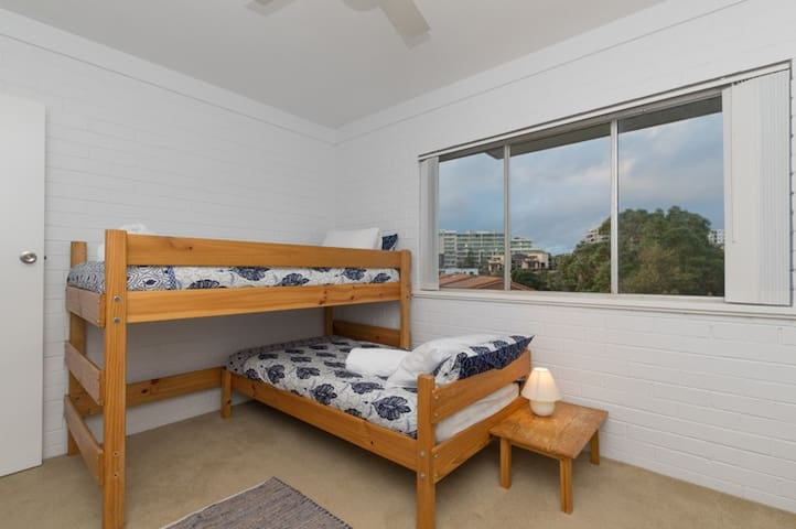 Downstairs, the second bedroom. Complete with 2 x single beds, robe, en-suite and an amazing view from the windows over looking Scarborough Beach.