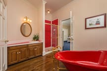 Jack and Jill Bathroom upstairs with red claw foot tub