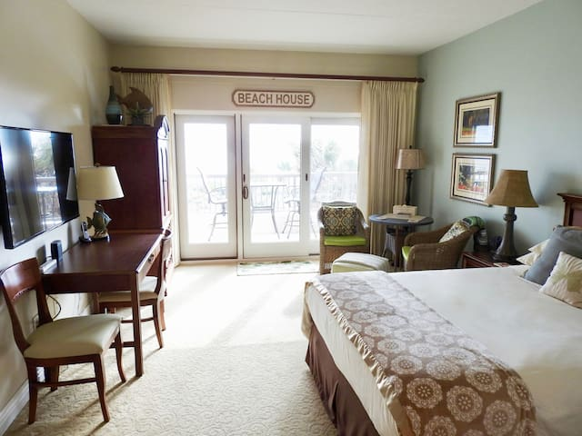Oceanfront main room with Queen bed, sitting area, desk, HDTV, high speed internet.