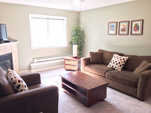 Comfortable couch and chair, and new soft carpet.