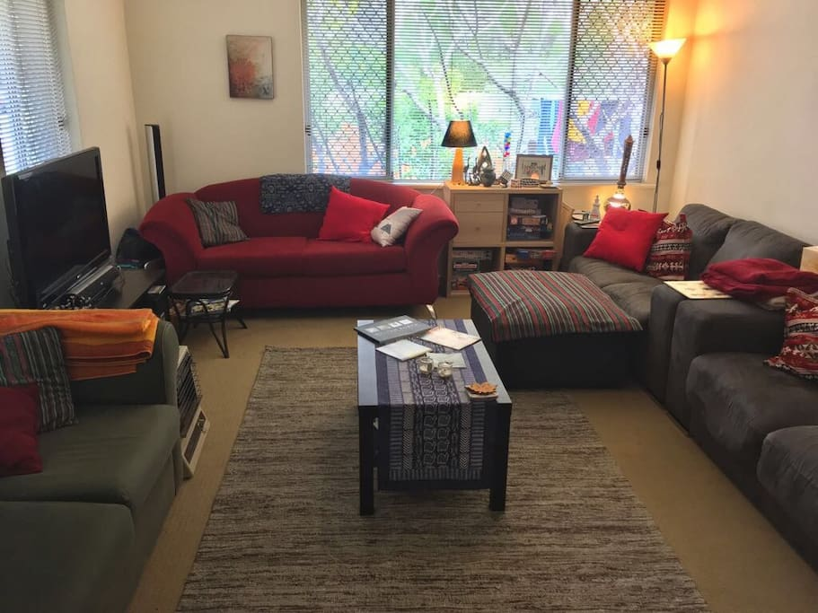 Our cozy living area with plenty of couches, as well as shared access to a DVD player, Apple TV, Netflix, and Stan.