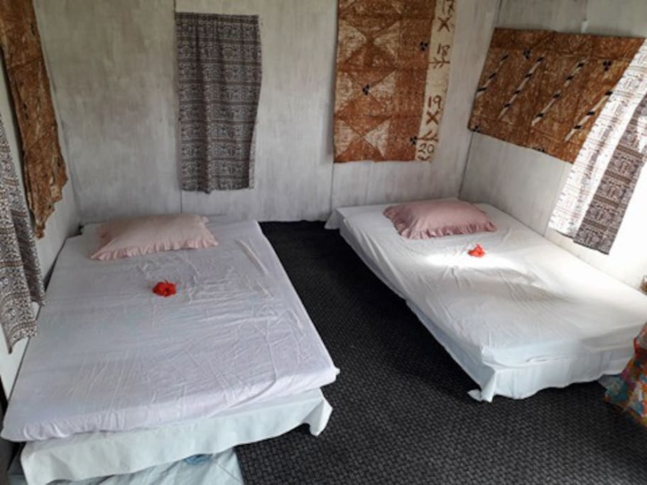 Inside the homestay where two beds are available.