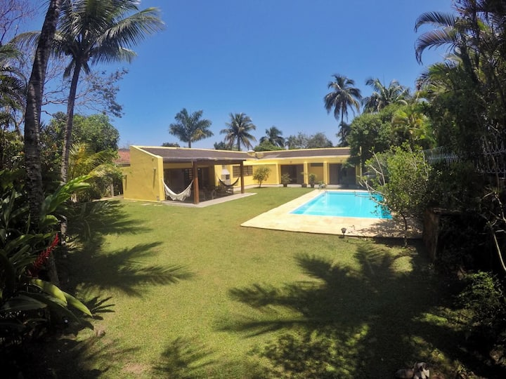 Yelow House with palm garden and swimming pool.