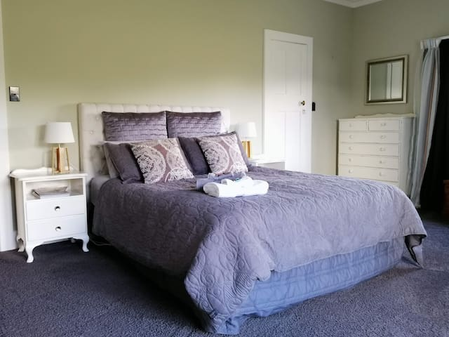 Bedroom 1  comes with a queen bed with direct access to adjoining bathroom and French doors  opening onto the deck.