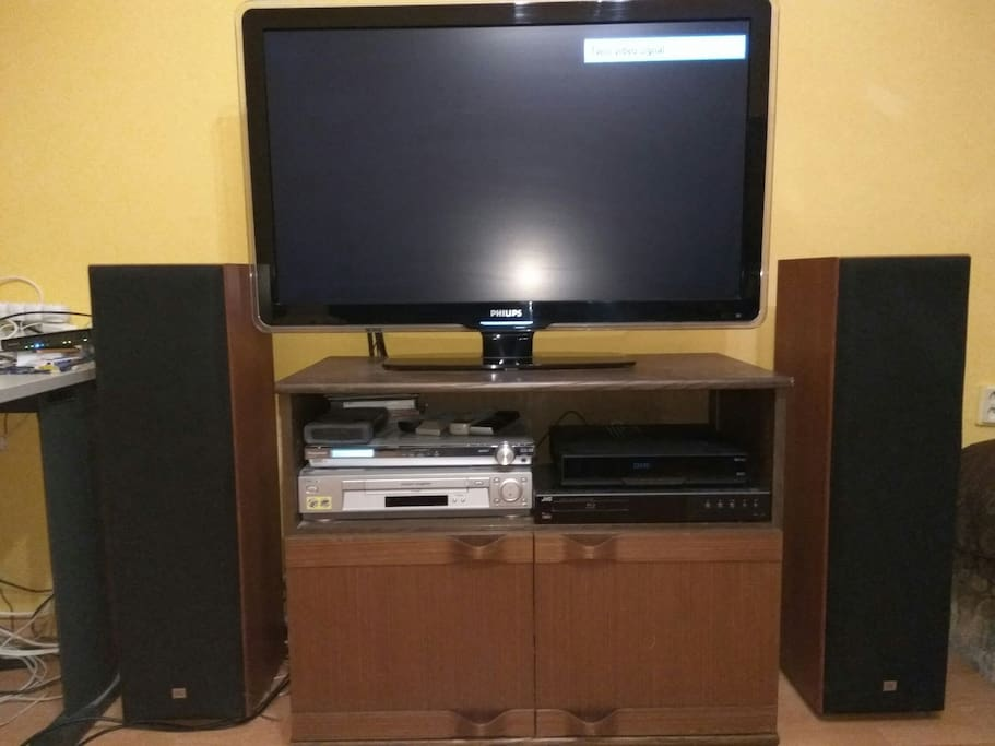 TV with audio system and speakers. Satellite TV with DVR. Blue-ray and video player.