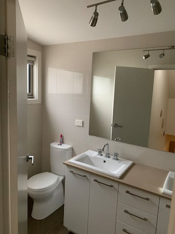 Upstairs bathroom, with bath, double vanity and toilet
