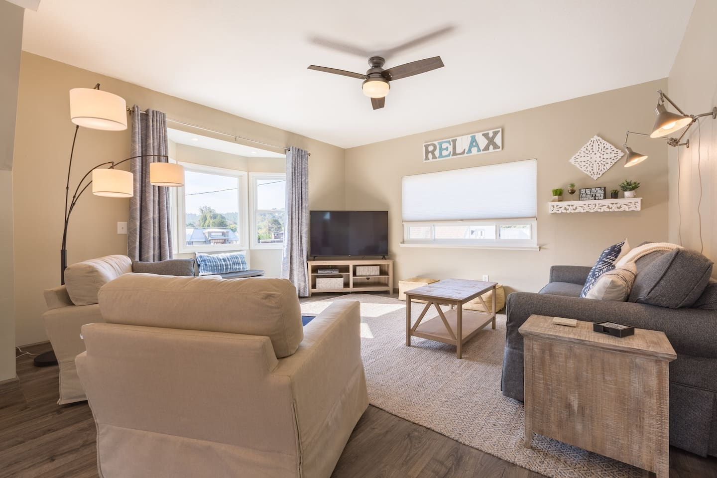 """Comfortable living area with 60"""" smart TV."""