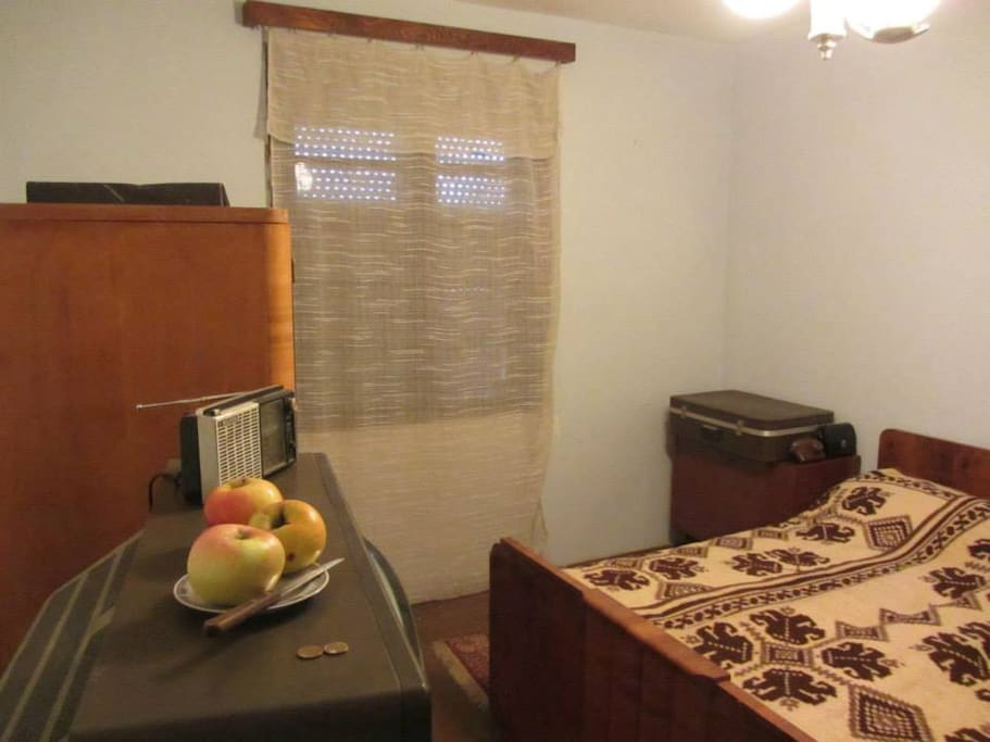 Room 1- frozen in the 70s all with the TV with home antenna, radio, suitcase, village night lamp and camera...