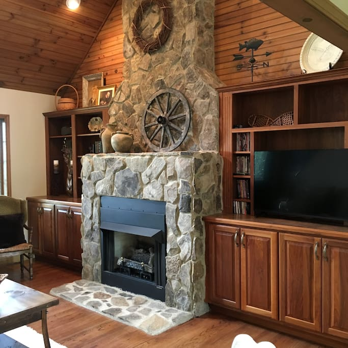 Stone fireplace with bookcases and flat screen tv.