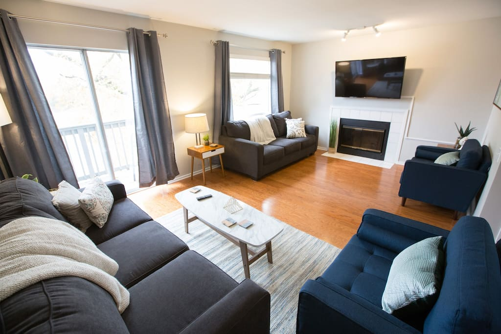 "You'll feel comfy, cozy, and refreshed in our stylish living room. A great place to crash after being out on the town! Enjoy our 55"" Smart TV. You can also relax on the balcony that overlooks the river!"
