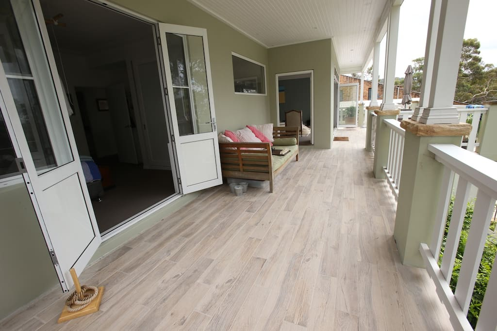 The wide deck winds around the house & enjoys elevated district views