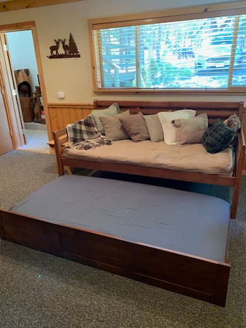 downstairs daybed with twin futon mattress and a pull-out twin mattress