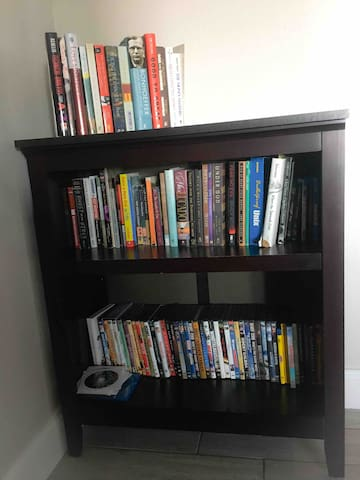Book and dvd/blu-Ray collection. Also, there is a Apple TV with a collection of digital movies.