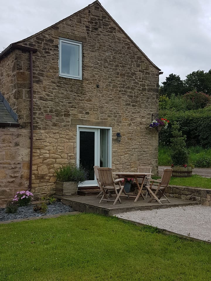 Holly Cottage with outside seating  Guests are welcome to sit in the garden and walk around the fields