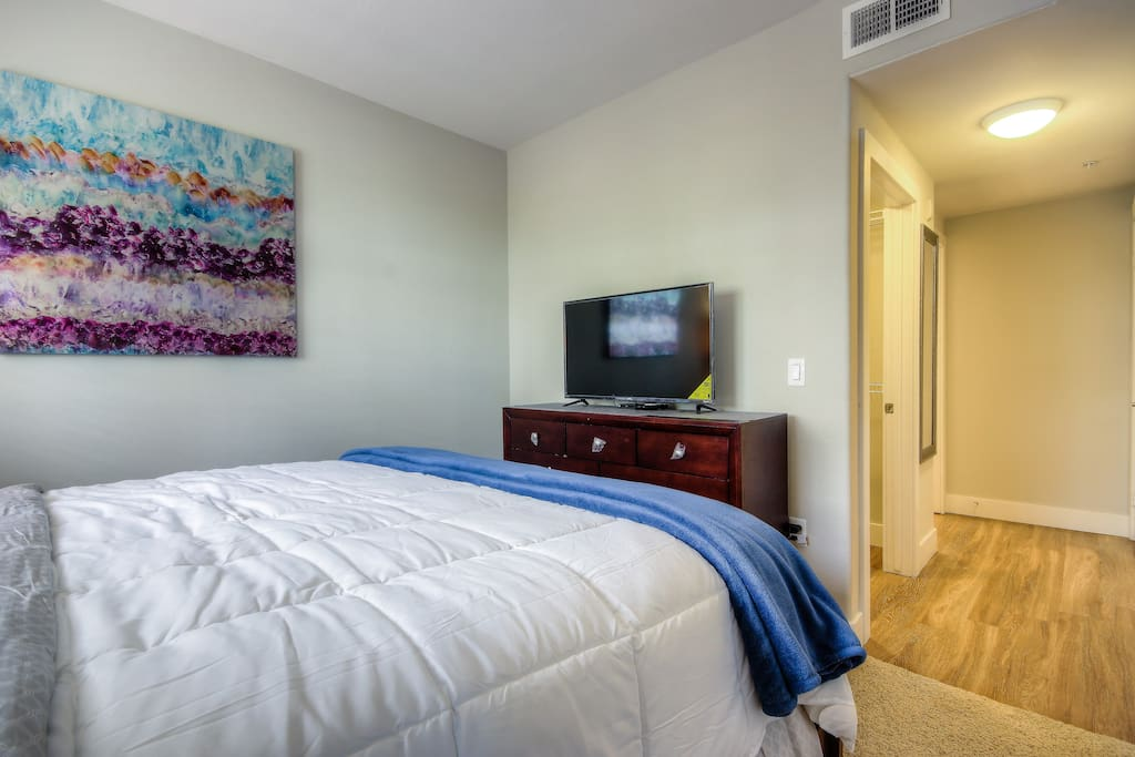 Cal-King size bed with TV in the master bedroom