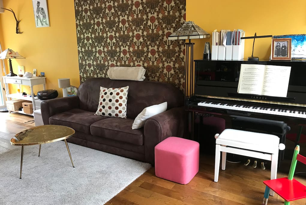 Comfortable sofa and piano in the living room