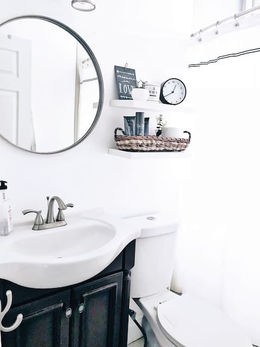 Full-sized bathroom with owners