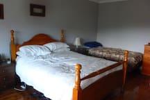 Bedroom 1 - 1 Queen Bed, 2 Single beds & TV with inbuilt DVD player.