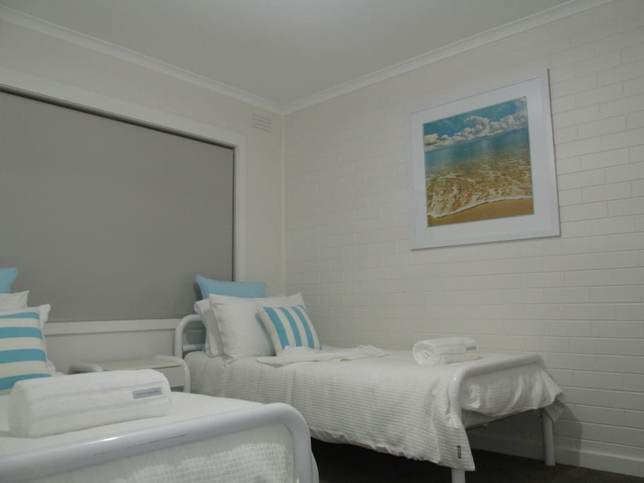 Bedroom 2 with 2 single beds and all brand new bedding.