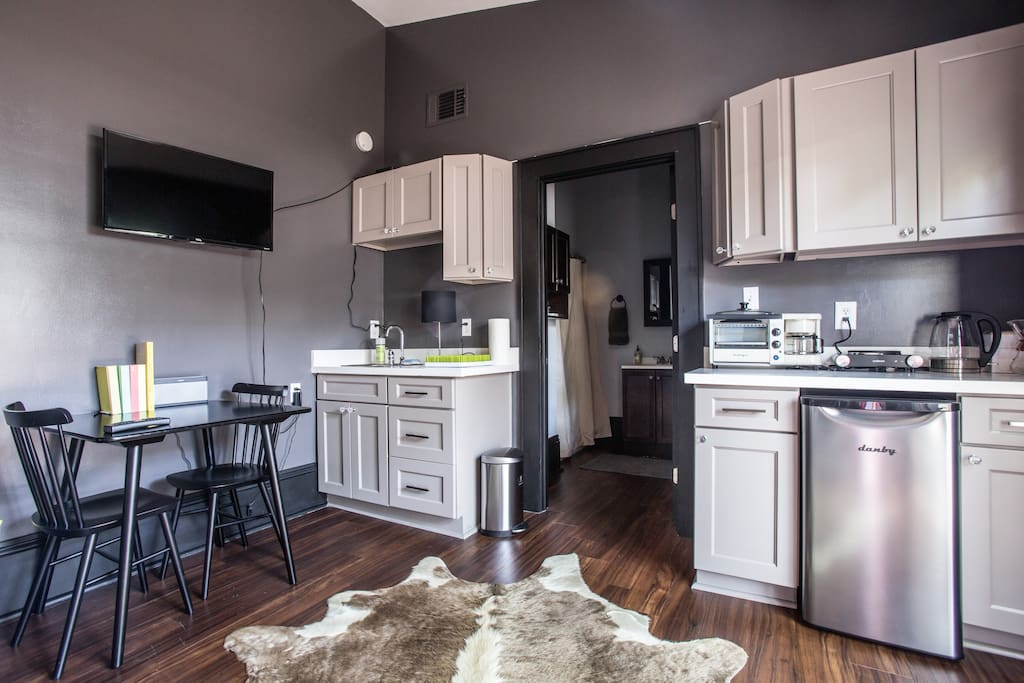 Sink, TV (cable), small refrigerator, hot plate,  table for two, multiple coffee maker options, toaster oven, etc..,