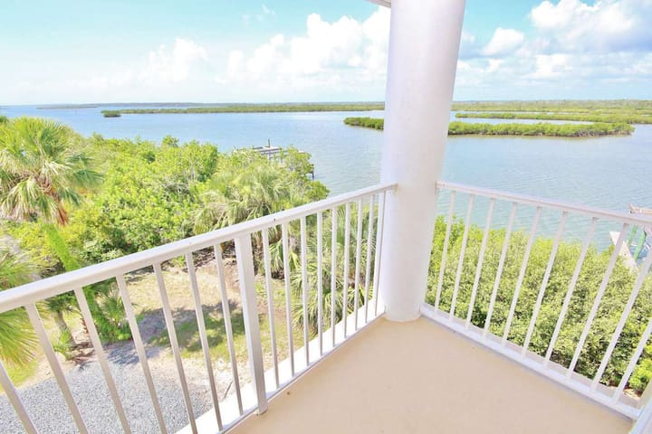 Lavish - This is a grandiose three story home located on a picturesque lagoon