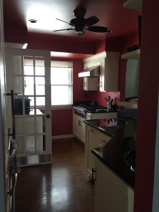 Kitchen on main level includes sub-zero freezer, Wolfe gas stove, dishwasher, and plenty of counter space.