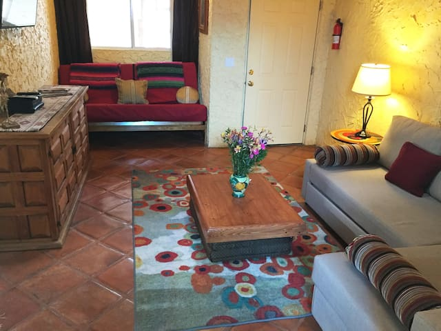 The living room in the Mexican Suite has a double sleeper sofa and a double futon bed.