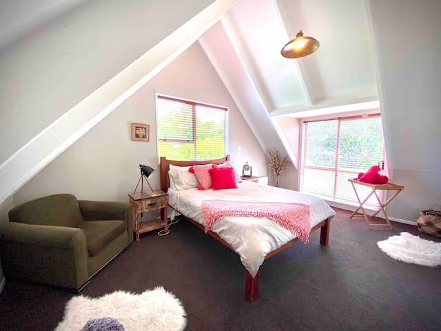 Spacious, sunny master bedroom with Queen bed, two armchairs and a private balcony. Large wardrobe and plenty of storage.