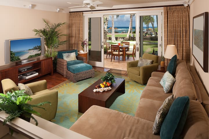 Ocean view from living room with new furniture and 55in smart TV