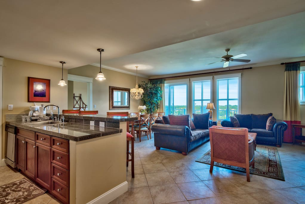 Kitchen area overlooking living and dining area