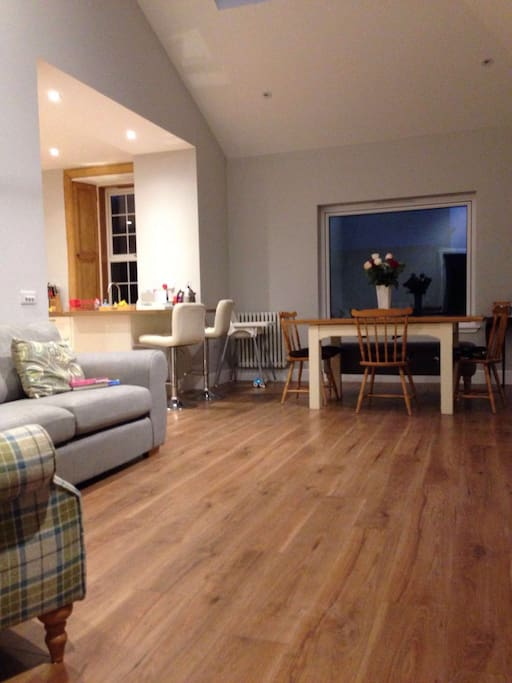 Spacious living/dining area at rear of house, with doors to garden