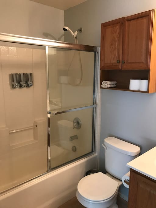Private bathroom with shower and bathtub. Shampoo, Conditioner, and body wash provided.
