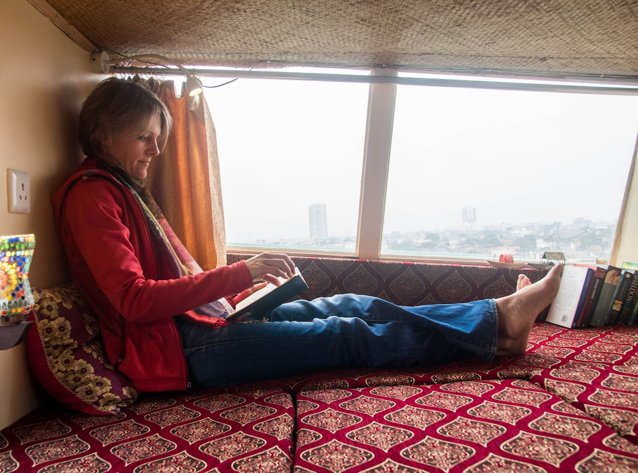 Our Guest Lisa lounging with a favourite book in the Sundeck.
