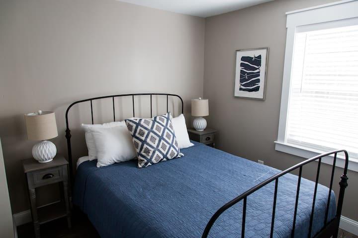 Bedroom 2: Queen Bed, closet and dresser.